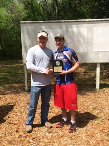 Paul presenting Tyler with the Open Pistol 1st place award
