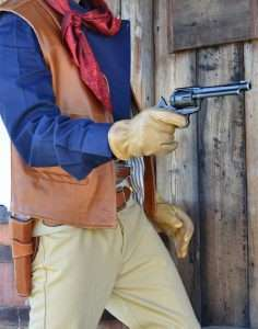 "Wearing a copy of the famous ""Duke"" rig worn by JOhn Wanyne in many of his films, the author quick draws the limited editon ""Duke"" Model SAA. (Holster by John Bianchi Frontier Gunleather)"