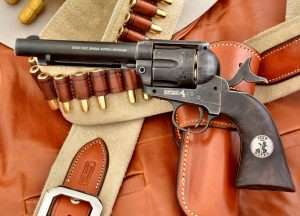 "The ""Duke"" SAA pellet model has wood grained grips with a John Wayne ""Duke"" medallion."