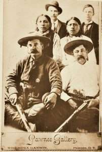 Legendary Oklahoma lawman Heck Thomas (seated at left) carried a Colt Single Action and Winchester lever action rifle in pursuit of outlaws.