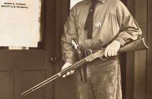 The author in an article about Heck Thomas and the Three Guardsmen of Oklahoma, posed as Thomas wearing a copy of his holster, Colt Single Action, and an original Winchester Model 1873 chambered in .44-40.