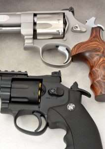 Notice the trigger positions with the hammer down. Double action trigger pull has to cock the hammer and rotate the cylinder. With the hammer manually cocked, the trigger no longer has to rotate the cylinder and moves further back for a single action shot. In between these two extremes, the trigger can be staged for a more accurate double action shot.