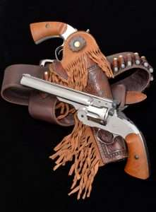 The S&W topbreak revolvers, including g civilian models of the Schofield, found their way into the holsters of lawmen, like Virgil Earp and Dallas Stoudenmire, cowboys and cattlemen, as well as notorious outlaws like John Wesley Hardin and Jesse James. The nickel plated Bear River Schofield is an extremely accurate copy of the famed S&W .45 Schofield Model. (Holster by .45Maker, cartridge belt by John Bianchi Frontier Gunleather)