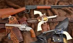 The Guns that Won the West included single action revolvers from Colt and Smith & Wesson, and Winchester lever action rifles. Modern CO2-powered Old West guns not only provide the look but the feel of the original 19th century designs. Pictures at top the Umarex lever action rifle, far left two nickel plated Schofield revolvers from Bear River, center two hand engraved Umarex Colt Peacemakers with a Western Justice holster and cartridge belt, and at lower right the standard blued model Umarex Colt SAA with a Cavalry holster and belt by John Bianchi Frontier Gunleather.