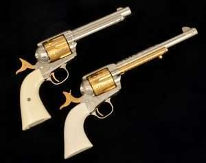 The original 1870's Nimschke gun and the Adams & Adams copy both had gold plated hammers, trigger, cylinders and ejectors. The Adams & Adams Umarex Colt version has a real gold plated cylinder, hammer and trigger.