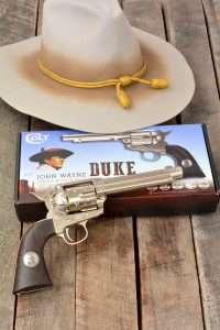 "In some of John Wayne's early ""B"" Western, his character carried a nickle plated 5-/12 inch Colt. The hand engraved Umarex Colt is offered in Limited Eition BB and pellet models."