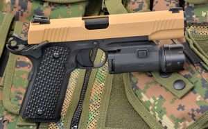 The 1911's Picatinny rail is the same size and design as the .45 ACP M45 CQBP used by elite Marine Corps special operations units since 2012. The Umarex is shown with a Walther Night Force tactical light/laser combination.
