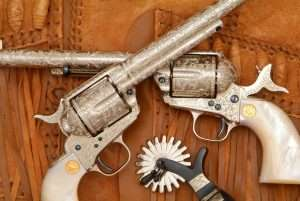 One of the great American masters of Western engraving was Howard Dove. Done in a combination of styles, this cased pair of Dove engraved 2nd Generation Colt .45s show the ultimate in hand engraving, 100 percent coverage.