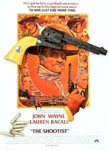 "The poster from the 1976 film shows all of the legendary actors who made The Shootist one of John Wayne's best western films of all time, Richard Boone (upper left), High O'Brian (upper right), Jimmy Stewart (lower right) Lauren Bacall (lower left) and John Wayne. The limited edition hand engraved 4.5mm Umarex Colt ""Shootist"" Peacemaker is copies from one of the guns carried by Wayne in the film."