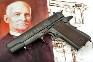 Pictured with a portrait of the 1911's inventor, John M. Browning, and a copy of the patent for the 1911 dates Feb. 12, 1911, the CO2-powered Tanfoglio Witness 1911 is the closest in design to the later c.1924 version 1911A1.