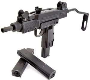 The Mini Uzi has a folding skeleton shoulder stock, selector switch for SAFE, FIRE and FULL AUTO at the top of the pistol grip and uses self contained CO2 BB magazines.