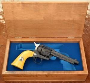 The blue presentation box liner is French fit for the gun to rest inside the cutout.