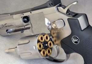 The metal pellet shells are stamped DAN WESSON around the rims. The frame-mounted cylinder release lever also functions as a manual safety by pulling it to the rear.