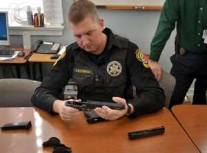 Bedford County, Pennsylvania Deputy Brian Kaszubski disassembles the M&P40 airgun while comparing it to his field stripped .40 S&W model. One of the first things the officers did was fit the interchangeable backstraps to their hands to match the their .40 S&W duty guns.