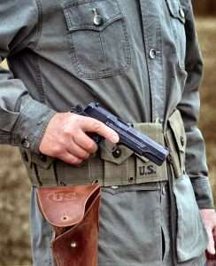 For the gun test the author carried the John Wayne 1911A1 in a weathered reproduction of the WWII era 1911 holster. This is the same type of holster used by John Wayne in WWII movies.