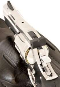 The ASG Dan Wesson Model 715 has excellent windage and elevation adjustable rear sights and a tall, serrated front sight that is dovetailed and pinned. Note the small safety lever at the base of the hammer. The safety indicator (red dot and white dot) are on the right side of the frame.