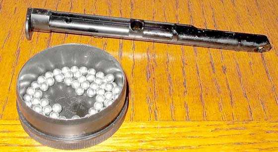 Winchester 16 shot BB pistol magazine on table