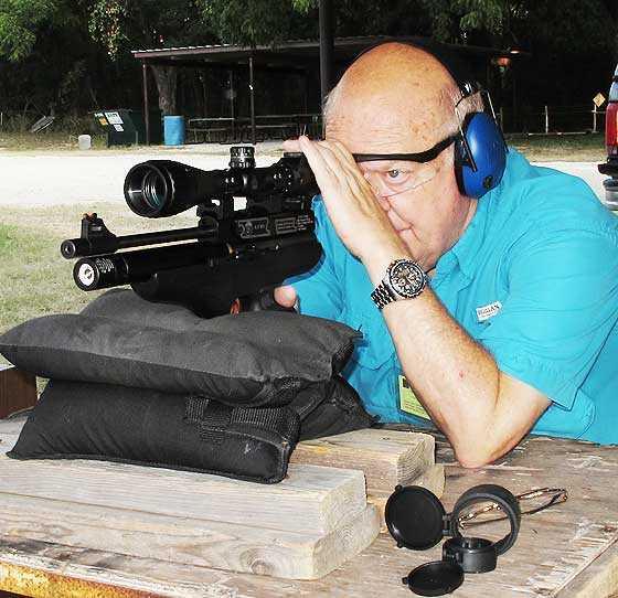 Hatsan AT P1 air pistol held on bag