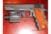 1911 - added real wooden cocobolo grips along with pearce finger grips, under barrel rail system, and Nebo protech 190 laser/light
