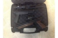 Pistol case - Will hold two on top. Not to sure about underneath. I just keep manuals etc below