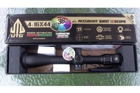 UTG 4-16x44 rifle scope NIB - Top view of the scope and the factory box.