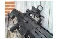 Crosman MK-177, Black - Crosman MK-177 with AR-15 carry handle and red dot sight.