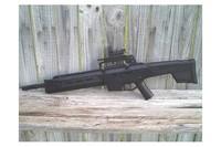 Crosman MK-177 - Crosman MK-177 with AR-15 carry handle and red dot sight.
