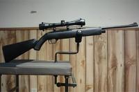 Crosman 1077 - Crosman 1077 with Winchester 4X32 air rifle scope.