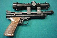 2240 with walnut grips right side - Crosman 2240 with BSA scope and genuine walnut wood grips, right side
