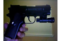 Colt Defender W/ Laser sight - My colt defender with a daisy laser sight