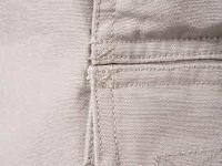 Close up on sturdy bar tack finish (Khaki pant).