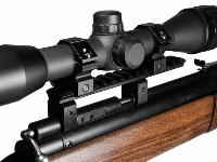The rings attach to the Picatinny rail. Shown with scope mounted. Gun is shipped with unmounted scope.